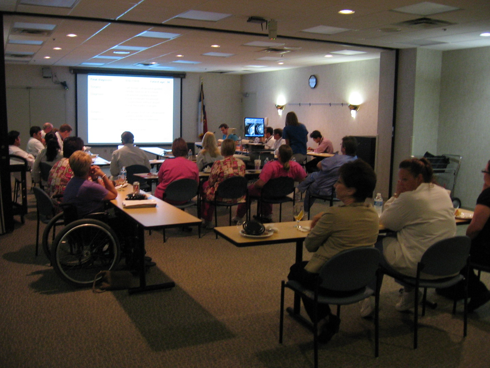 2001 photograph of our comprehensive breast conference held at Houston Northwest Medical Center hospital. In attendance are surgeons, medical and radiation oncologists, pathologists and mammographers. Also, present are key members of the breast support group. The equipment and presentation techniques have improved over the years. We are in our 22nd year as of 2018.